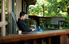 Working: Man Telecommuting With Laptop On Porch by Sean Locke ...